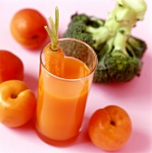 Carrot juice, fruit and broccoli