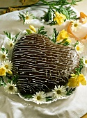 Tree cake heart with chocolate icing and flowers