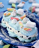 Sugar cloud (meringue cake with blueberries and candy sticks)