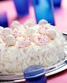 Festive white coconut gateau with coconut chocolates