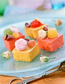 Petit fours with jellied fruits and candied roses