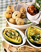 Barbecued avocados with olive salad and potatoes with sea salt
