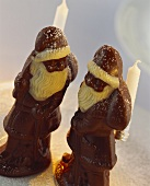Chocolate Father Christmases, decorated with candle