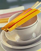 Asian place setting with chopsticks in home-made packets