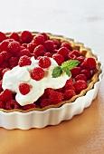 Raspberry tart with cream