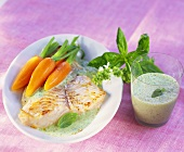 Hake with carrots and herb sauce