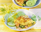 Herb omelette with salmon and cucumber slices