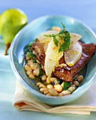Calf's liver with beans, rocket and pear