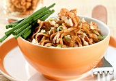 Fried ribbon pasta with leeks and walnuts