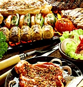 Various barbecue foods in marinade and on barbecue