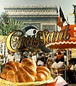 Fresh croissants, Arc de Triomphe behind, Paris