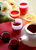 Fruit tea in cups and mugs
