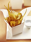 Root vegetable crisps in cardboard container