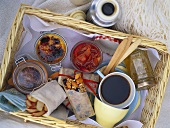 Picnic basket with coffee, desserts and snacks