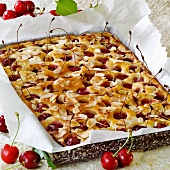 Tray-baked cake with sweet cherries and almonds