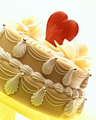 Iced marzipan cake with red heart