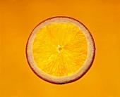A slice of orange against orange background
