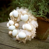 Door wreath with feathers and eggs
