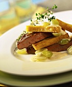 Fried calf's liver with polenta slices and grapes