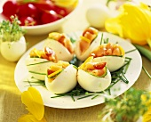 Eggs stuffed with salmon and garnished with chives