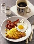 Rosti with fried egg and bacon