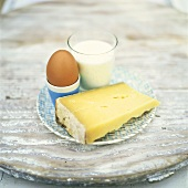 Still life with cheese, egg and milk