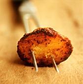 Roast potato on fork