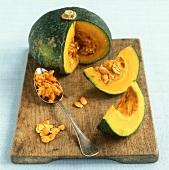 Pumpkin, slices cut, and pumpkin seeds