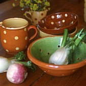 Still life with fennel, turnip and pottery