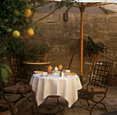 Laid table with melon and tea service