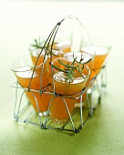 Iced rooibos tea with orange juice & rosemary in bottle basket