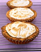 Lime and lemon tartlets with meringue topping