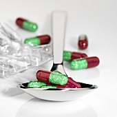 Vitamin capsules on spoon
