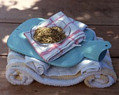 Dried herbs, towels and hot-water bottle