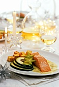 Salmon steak with avocado and diced potatoes