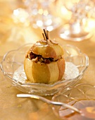 Baked apple with hazelnut and raisin filling
