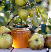 Home-made apple jelly and apples