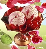 Vanilla and cherry ice cream with cherries and roses