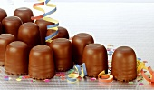 Chocolate marshmallows with party decorations