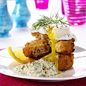 Fish cakes with poached egg and remoulade sauce