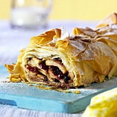 Sweet strudel with fruity filling, a piece cut