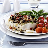 Cod fillet with tomato and olive crust