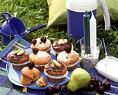 Cherry and pear muffins on a picnic cloth