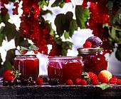 Still life with three red jams