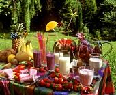 Summer party: strawberries, ice cream, milkshakes etc. on table
