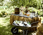 Drinks buffet on bales of hay for a summer party