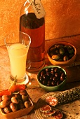Still life with olives, saucisson (pepper salami) & Pastis