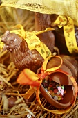 Easter sweets: chocolate chicken & chocolate egg on straw