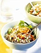Rice salad with vegetables, chili and raisins