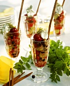 Berry salad with cherries, cream and mint in glasses